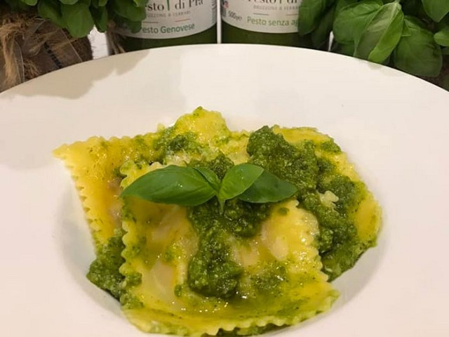 Burrata and sugared onion ravioli with pesto sauce