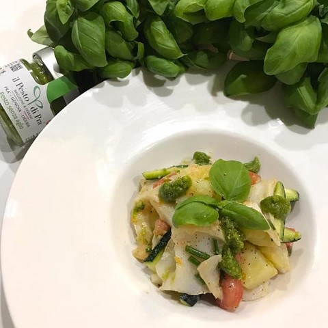 Stockfish salad with cherry tomatoes, boiled potatoes, raw courgettes and Pesto di Pra'